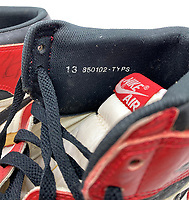BNPS.co.uk (01202) 558833<br /> Pic: GreyFlannelAuctions/BNPS<br /> <br /> Pictured: Details of the signed Michael Jordan's trainers.<br /> <br /> A pair of Michael Jordan's trainers from his debut basketball season have sold for over £300,000.<br /> <br /> The basketball legend wore the red and white Nike Air Jordan 1 shoes during the 1984-85 season while playing for the Chicago Bulls.<br /> <br /> He gave his size 13.5 footwear to veteran photographer Robert Crawford after the Bulls played the Indiana Pacers in 1985.<br /> <br /> The popularity of Jordan trainers has been driven by last year's acclaimed documentary 'The Last Dance' charting his time at the Bulls.<br /> <br /> Mr Crawford, who has kept hold of the shoes for 36 years, offloaded them with Grey Flannel Auctions, of Scottsdale, Arizona, US.