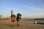 Israel, Tel Aviv-Yafo, hiking at the promenade