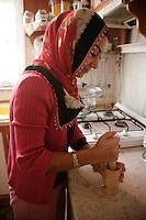 Kurdish girl pressing garlic, Istanbul, Turkey