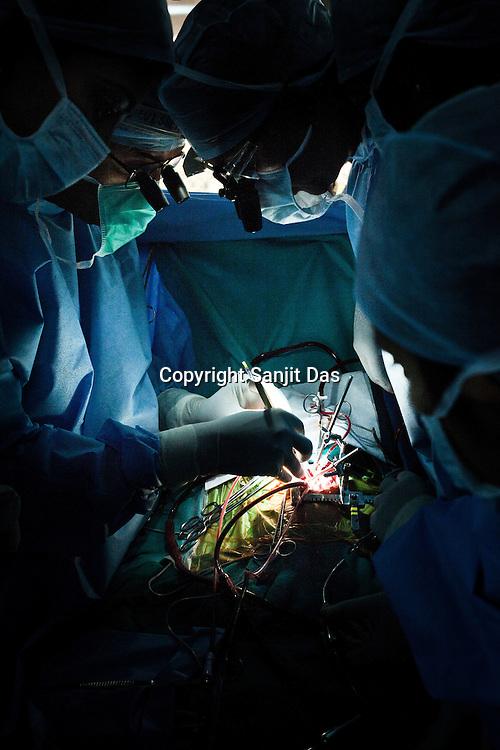 58 year old heart surgeon, Dr. Devi Prasad Shetty and his colleagues conduct an open heart surgery on 6 month old, Baby Kaushik at the Narayana Hrudayalaya in Bangalore, Karnataka, India. Photo: Sanjit Das/Panos
