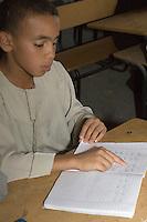Surman, Libya.  Boy Memorizing the Koran in the Madrasa of Sidi Rashid al-Galili.