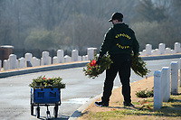 Volunteers collect wreaths Saturday, Jan. 9, 2021, while collecting the holiday wreaths at the Fayetteville National Cemetery. The wreaths were placed in front of each grave in the cemetery in December by volunteers through the Wreaths Across America program and were collected by groups of volunteers organized by the Fayetteville National Cemetery Advisory Council who worked in shifts because of the pandemic. Visit nwaonline.com/210110Daily/ for today's photo gallery. <br /> (NWA Democrat-Gazette/Andy Shupe)