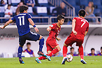Phan Van Duc of Vietnam (C) fights for the ball with Kitagawa Koya of Japan (L) during the AFC Asian Cup UAE 2019 Quarter Finals match between Vietnam (VIE) and Japan (JPN) at Al Maktoum Stadium on 24 January 2018 in Dubai, United Arab Emirates. Photo by Marcio Rodrigo Machado / Power Sport Images