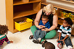 Education preschool first days of school 2-3 year olds two year old boy crying in teacher's lap
