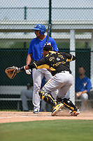 Pittsburgh Pirates Tomas Morales (38) throws down to second on a pitch in the dirt as Derrick Loveless (28) looks on during a minor league spring training game against the Toronto Blue Jays on March 26, 2015 at Pirate City in Bradenton, Florida.  (Mike Janes/Four Seam Images)