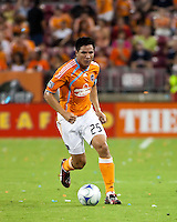 Houston Dynamo forward Brian Ching (25) moves the ball upfield.  Houston Dynamo defeated Chicago Fire 3-2  at Robertson Stadium in Houston, TX on August 9, 2009.