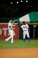 Buffalo Bisons center fielder Roemon Fields (37) and left fielder Michael Saunders (5) celebrate closing out a game against the Pawtucket Red Sox on August 31, 2017 at Coca-Cola Field in Buffalo, New York.  Buffalo defeated Pawtucket 4-2.  (Mike Janes/Four Seam Images)
