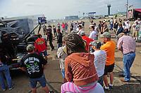 May 20, 2012; Topeka, KS, USA: NHRA fans watch as top fuel dragster driver Cory McClenathan warms up his car in the pits during the Summer Nationals at Heartland Park Topeka. Mandatory Credit: Mark J. Rebilas-