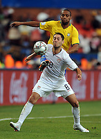 Clint Dempsey (8) of USA and Maicon (back) of Brazil. Brazil defeated USA 3-0 during the FIFA Confederations Cup at Loftus Versfeld Stadium in Tshwane/Pretoria, South Africa on June 18, 2009.