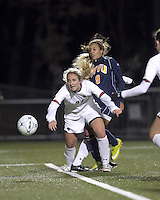 "Corner kick: Boston College midfielder Kate McCarthy (21) and West Virginia forward Frances Silva (9). Boston College defeated West Virginia, 4-0, in NCAA tournament ""Sweet 16"" match at Newton Soccer Field, Newton, MA."