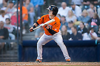 Mike Yastrzemski (4) of the Bowie Baysox squares to bunt against the Richmond Flying Squirrels at The Diamond on May 23, 2015 in Richmond, Virginia.  The Baysox defeated the Flying Squirrels 3-2.  (Brian Westerholt/Four Seam Images)