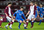 Hearts v St Johnstone....11.01.11  Scottish Cup.Chris Millar closed down by Ryan Stevenson and Ruben Palazuelos.Picture by Graeme Hart..Copyright Perthshire Picture Agency.Tel: 01738 623350  Mobile: 07990 594431