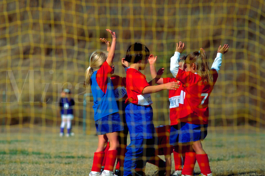 """Young girls' soccer team giving """"""""high five"""