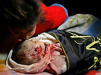 """The brothers of one-month-old Palestinian baby girl Amira Abu Asser cries near her body during her funeral in Gaza city, on March 5, 2008. The baby and a senior Islamic Jihad militant were killed during an Israeli brief military incursion into Gaza today, overshadowing a new peace push by US Secretary of State Condoleezza Rice.""""photo by Fady Adwan"""""""