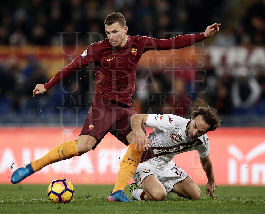Calcio, Serie A: Roma, stadio Olimpico, 19 febbraio 2017.<br /> Roma's Edin Dzeko (l) in action with Torino's Emiliano Moretti (r) during the Italian Serie A football match between As Roma and Torino at Rome's Olympic stadium, on February 19, 2017.<br /> UPDATE IMAGES PRESS/Isabella Bonotto