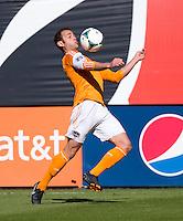 Brad Davis (11) of the Houston Dynamo controls the ball on his chest during a Major League Soccer game at RFK Stadium in Washington, DC. D.C. United vs. Houston Dynamo, 2-1.