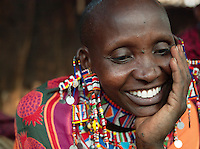 Maasai tribeswoman smiling, Tipilit village near Amboseli National Park, Kenya