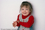 portrait of 3 year old girl smiling closeup Down syndrome horizontal