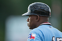 Hickory Crawdads coach Sharnol Adriana (12) coaches first base during the game against the Kannapolis Intimidators in game one of a double-header at Kannapolis Intimidators Stadium on May 19, 2017 in Kannapolis, North Carolina.  The Crawdads defeated the Intimidators 5-4.  (Brian Westerholt/Four Seam Images)