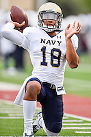 Navy quarterback Tago Smith (18) warms up before NCAA Football game kickoff, Saturday, September 13, 2014 in San Marcos, Tex.(Mo Khursheed/TFV Media via AP Images)