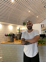 BNPS.co.uk (01202 558833)<br /> Pic: AaronBryans/BNPS<br /> <br /> Pictured: Owner Aaron Bryans.<br /> <br /> A vegan restaurant owner says heavy-handed officials are forcing him to remove a wall mural because it contains misleading information.<br /> <br /> Trading standards inspectors said half the wall at Plant Hustler would need to be covered immediately for making unproven health claims.<br /> <br /> They also said they would need to change their menu because using words like cheese, prawns and garlic butter is misleading.<br /> <br /> Owner Aaron Bryans said the inspectors were heavy-handed and people eating in a vegan restaurant would know they are not being served actual cheese, but a vegan alternative.