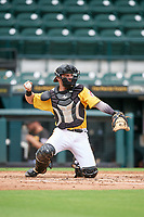 FCL Pirates Gold catcher Claudio Finol (25) warms up the pitcher during a game against the FCL Rays on July 26, 2021 at LECOM Park in Bradenton, Florida. (Mike Janes/Four Seam Images)