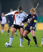 Annike Krahn (5) tries to maintain the ball against Lori Chalupny (17). US Women's National Team defeated Germany 1-0 at Impuls Arena in Augsburg, Germany on October 29, 2009.