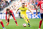 Antoine Griezmann of Atletico de Madrid and Santi Cazorla of Villareal CF during La Liga match between Atletico de Madrid and Villareal CF at Wanda Metropolitano in Madrid Spain. February 24, 2018. (ALTERPHOTOS/Borja B.Hojas)