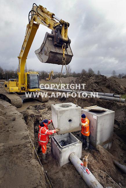 Arnhem, 290103<br /> Werkzaamheden nieuwbouwwijk Schuytgraaf. Aanleg riolering.<br /> Foto: Sjef Prins - APA Foto