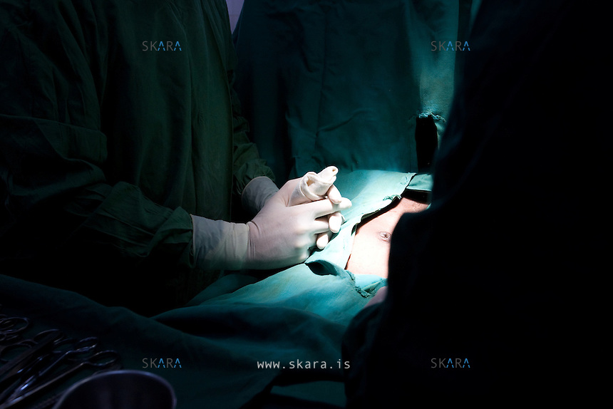 Sverrir is a very religious man. He prays before a surgery.