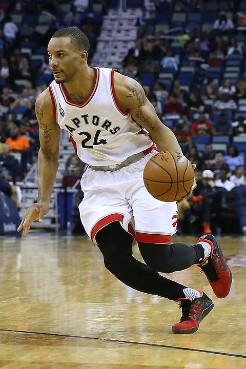 NEW ORLEANS, LA - MARCH 26:  Norman Powell #24 of the Toronto Raptors drives with the ball during a game at the Smoothie King Center on March 26, 2016 in New Orleans, Louisiana. NOTE TO USER: User expressly acknowledges and agrees that, by downloading and or using this photograph, User is consenting to the terms and conditions of the Getty Images License Agreement.  (Photo by Jonathan Bachman/Getty Images)