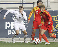 Amy LePeilbet #6 of the USA WNT races after Jun Ma #13 of the PRC WNT during an international friendly match at PPL Park, on October 6 2010 in Chester, PA. The game ended in a 1-1 tie.