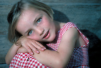 Young, smiling girl in red dress - close-up portrait. Leoni. Germany.