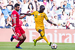 Awer Mabil of Australia (R) competes for the ball with Tareq Khattab of Jordan (L) during the AFC Asian Cup UAE 2019 Group B match between Australia (AUS) and Jordan (JOR) at Hazza Bin Zayed Stadium on 06 January 2019 in Al Ain, United Arab Emirates. Photo by Marcio Rodrigo Machado / Power Sport Images