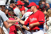 Philadelphia Phillies pitcher Vance Worley #49 signs autographs before a scrimmage against the Florida State Seminoles at Brighthouse Field on February 29, 2012 in Clearwater, Florida.  Philadelphia defeated Florida State 6-1.  (Mike Janes/Four Seam Images)