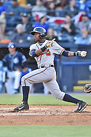 Rome Braves center fielder Ronald Acuna (24) swings at a pitch during a game against the Asheville Tourists at McCormick Field on April 14, 2016 in Asheville, North Carolina. The Tourists defeated the Braves 5-4. (Tony Farlow/Four Seam Images)