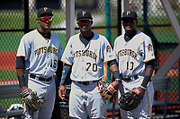 GCL Pirates Jeremias Portorreal (16), Rodolfo Castro (70), and Cristopher Perez (10) before a game against the GCL Tigers West on July 17, 2017 at TigerTown in Lakeland, Florida.  GCL Tigers West defeated the GCL Pirates 7-4.  (Mike Janes/Four Seam Images)