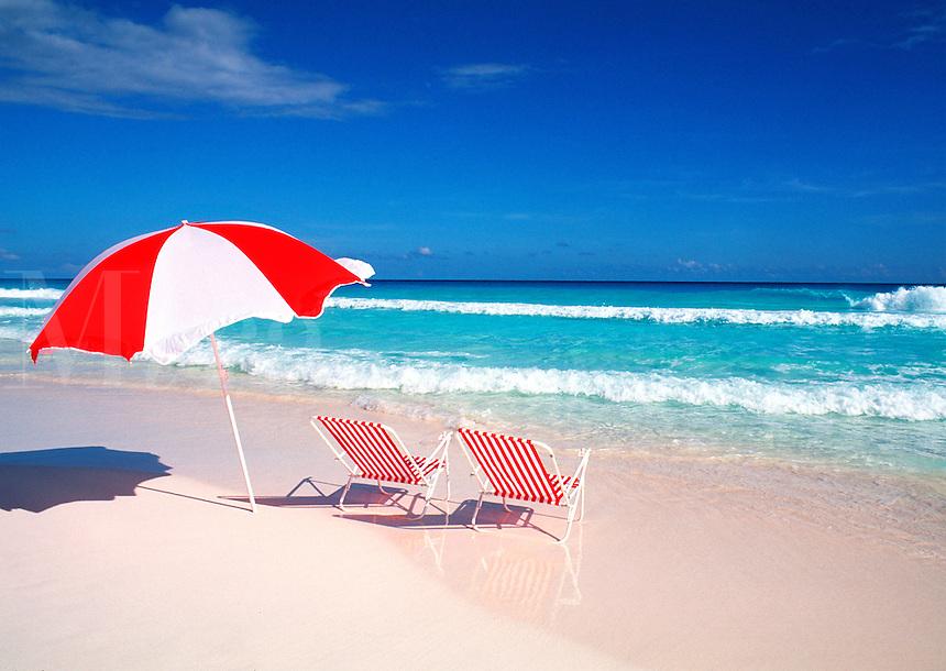 Red beach chairs and umbrella, horizontal