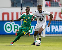 KANSAS CITY, KS - JUNE 26: Pernell Schultz #12 and Kevin Molino #10 go for the ball during a game between Guyana and Trinidad