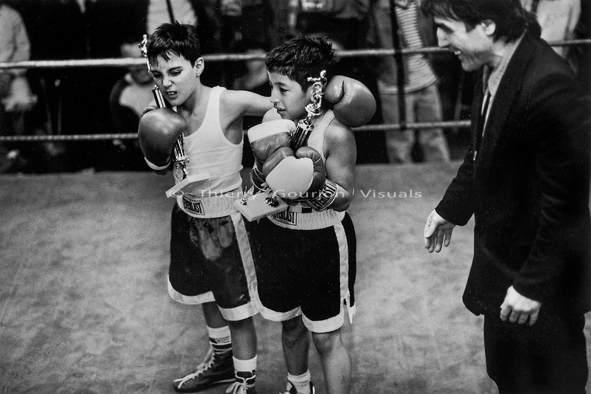 Two young fighters after an amteur fight at Gleason's Gym, Brooklyn, New York.<br />Photograph by Thierry Gourjon-Bieltvedt. 1995-2005