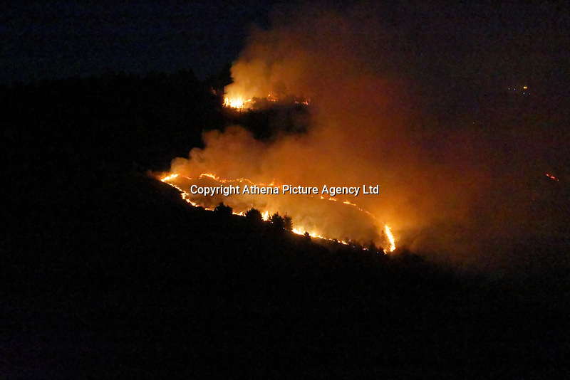Fire fighters are trying to extinguish a forest fire in Kilvey Hill, over houses in the Saint Thomas area of Swansea, Wales, UK. Thursday 16 May 2019