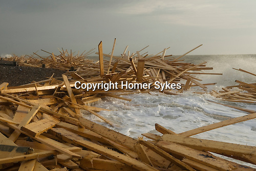 """The beach at Worthing, West Sussex, England. Planks of wood from the freighter the """"Ice Prince"""" which sank in rough weather on January 15th, came ashore a week later. January 21 2008."""