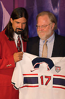 2005 Hall of Fame inductee Marcelo Balboa, and Director of Communications, Jack Huckel show Balboa's National Team jersey that was presented to the hall. National Soccer Hall of Fame induction ceremony. Wright Soccer Campus, Oneonta, NY, on August  29, 2005.