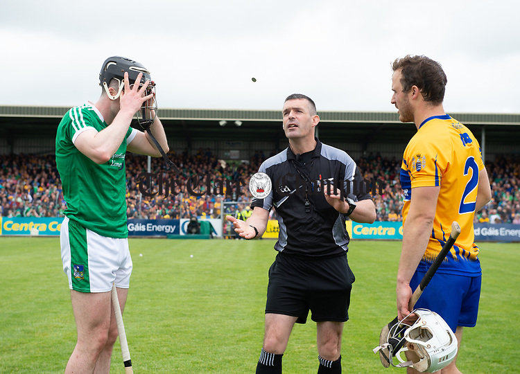 Team captains Declan Hannon of Limerick and Patrick O Connor of Clare with referee James Owens before their Munster championship game in Ennis. Photograph by John Kelly.