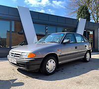 BNPS.co.uk (01202 558833)<br /> Pic: HampsonAuctions/BNPS<br /> <br /> Pictured: 1993 Vauxhall Astra 1.4 LS.<br /> <br /> Since the 1990s, Geoff Barlow, 46, has collected dozens of classic cars from an Escort Mexico replica to several types of Transit, Cortina, and Sierra.<br /> <br /> However, he still regrets selling the first car which inspired his passion, a 1980 Escort Mark 2 he bought from his sister in 1992.  <br /> <br /> Geoff's fascination with Fords gathered pace in the last decade and he 'lost control,' buying as many Fords as he came across and saving them from disrepair.