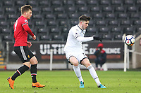 Sunday 18 March 2018<br /> Pictured:  Cian Harries of Swansea City is challenged by Zac Dearnley of Manchester United<br /> Re: Swansea City v Manchester United U23s in the Premier League 2 at The Liberty Stadium on March 18, 2018 in Swansea, Wales.