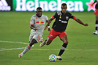 WASHINGTON, DC - SEPTEMBER 12: Ola Kamara #9 of D.C. United battles for the ball with Dru Yearwood #16 of New York Red Bulls during a game between New York Red Bulls and D.C. United at Audi Field on September 12, 2020 in Washington, DC.