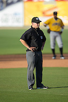 Umpire Chris Scott handles the calls on the bases during the South Atlantic League game between the West Virginia Power and the Kannapolis Intimidators at CMC-Northeast Stadium on April 21, 2015 in Kannapolis, North Carolina.  The Power defeated the Intimidators 5-3 in game one of a double-header.  (Brian Westerholt/Four Seam Images)