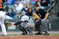 Scranton Wilkes-Barre RailRiders catcher J.R. Murphy #3 and umpire Ryan Blakney during a game against the Rochester Red Wings on June 19, 2013 at Frontier Field in Rochester, New York.  Scranton defeated Rochester 10-7.  (Mike Janes/Four Seam Images)