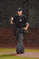 Umpire John Bostwick just before calling the game due to the rain between the Mississippi Braves and Mobile BayBears on April 28, 2015 at Hank Aaron Stadium in Mobile, Alabama.  The game was suspended after the top of the second inning with Mobile leading 3-0, the BayBears went on to defeat the Braves 6-1 the following day.  (Mike Janes/Four Seam Images)